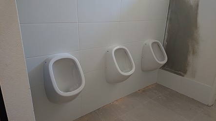 mens urinal installed