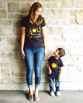 "Mother wearing a t-shirt with the writing ""You are my sunshine."" Child wearing t-shirt with a sun."